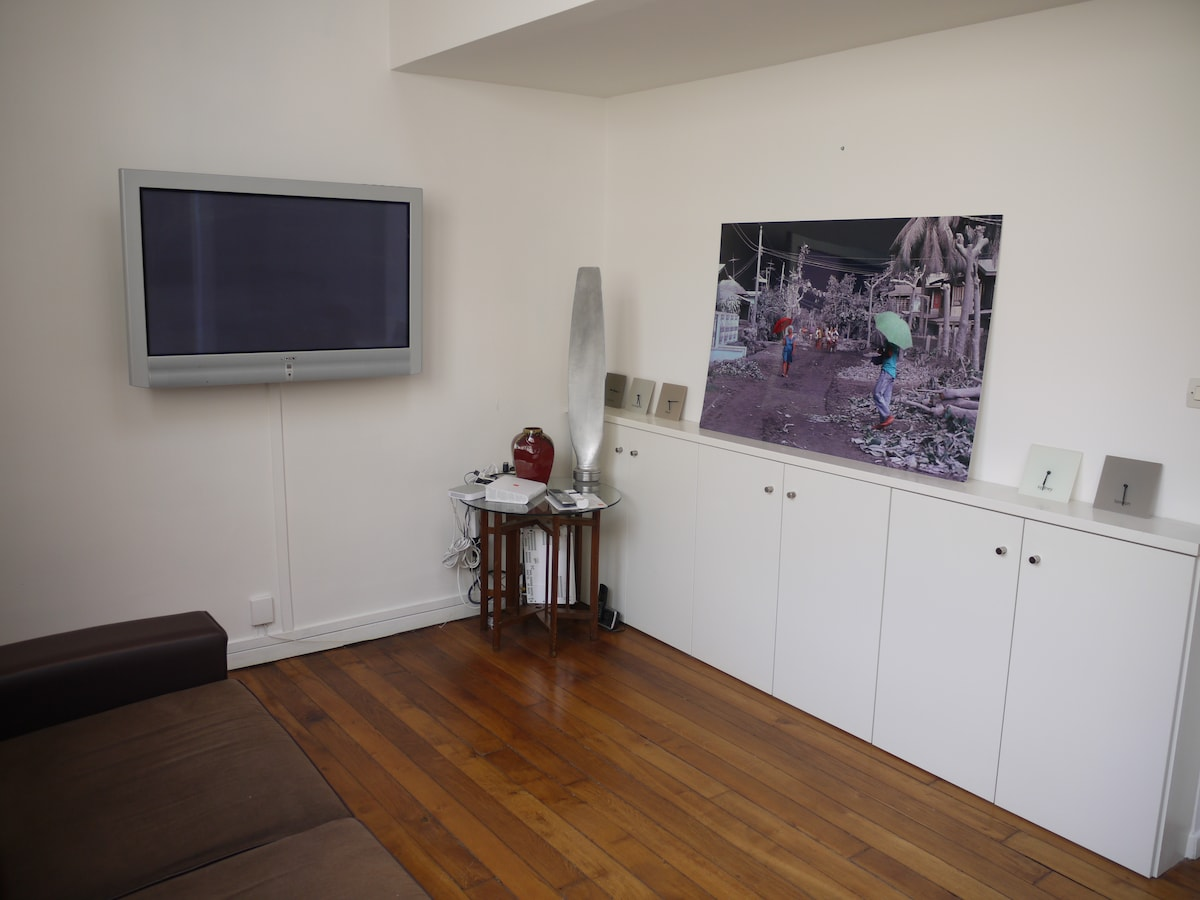 living room with flat screen TV with cable and internet