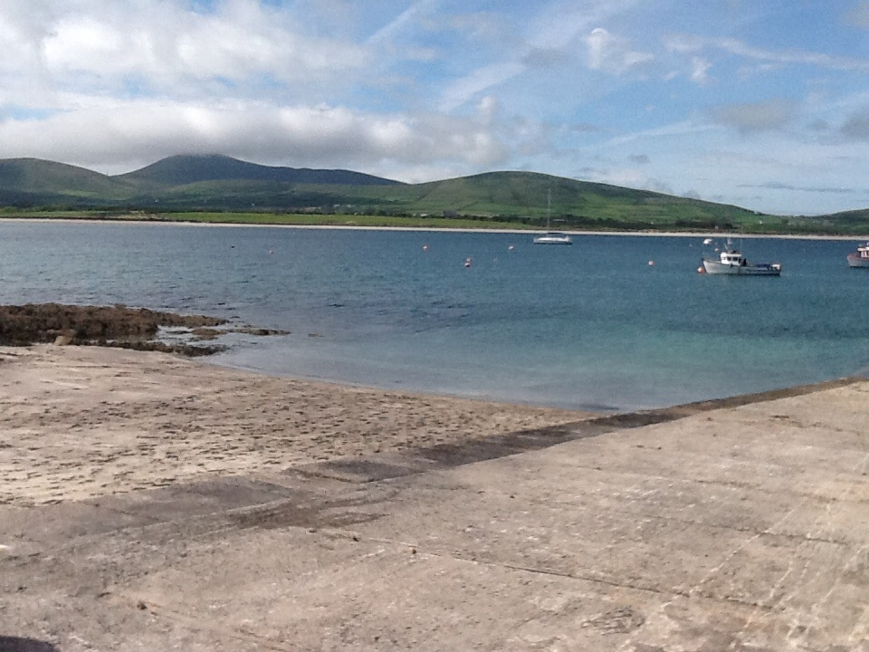 View of Ventry beach from pier, with Mount Eagle in the background.