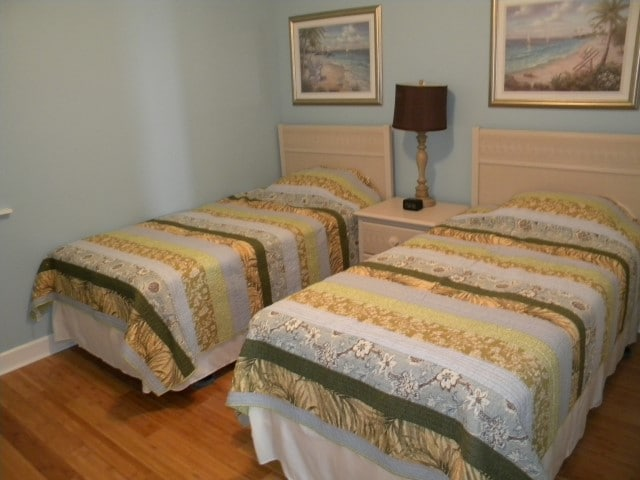 Guest Bedroom featuring two twin beds that can be converted into a King-size bed.