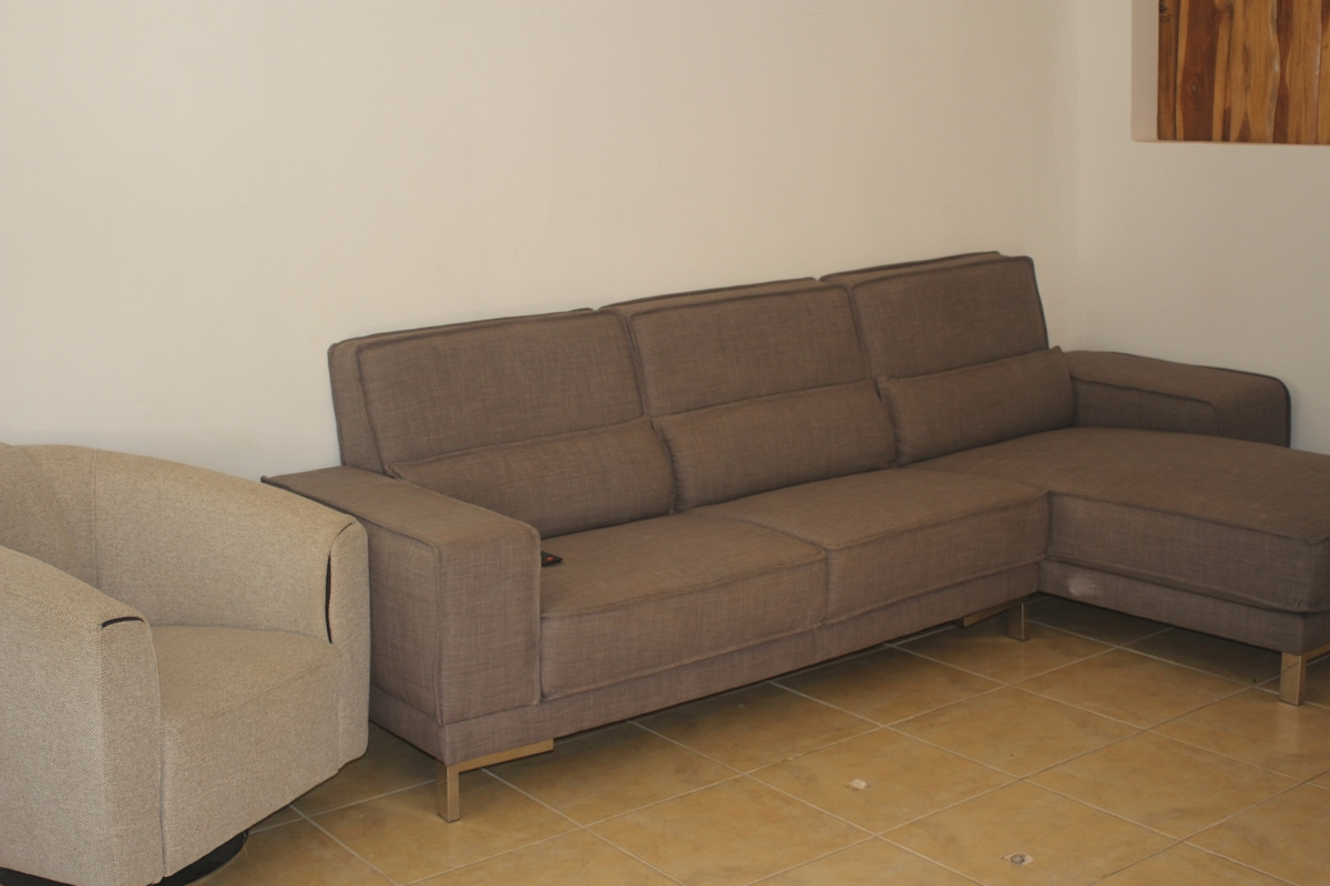 Huge living room with comfortable sofa, that one can easily pass out on as well :)