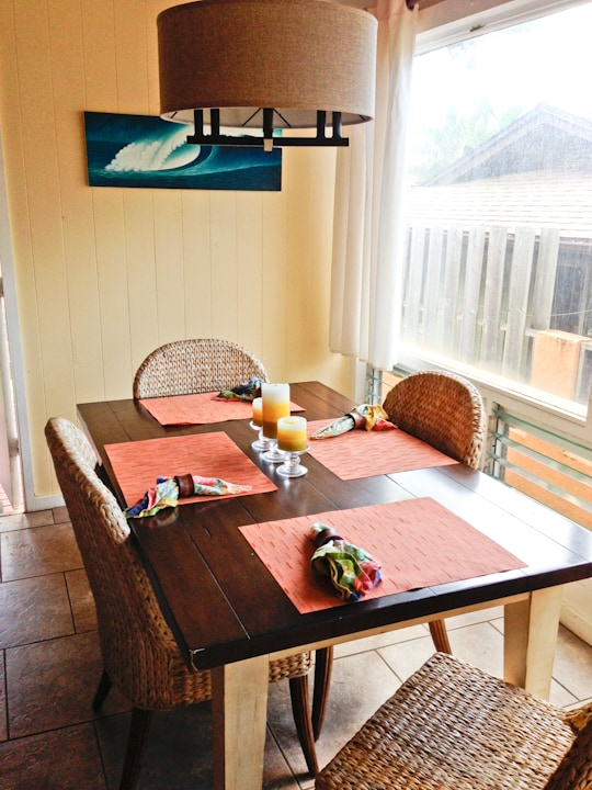 Dining room table perfect for enjoying meals or getting work done on your laptop