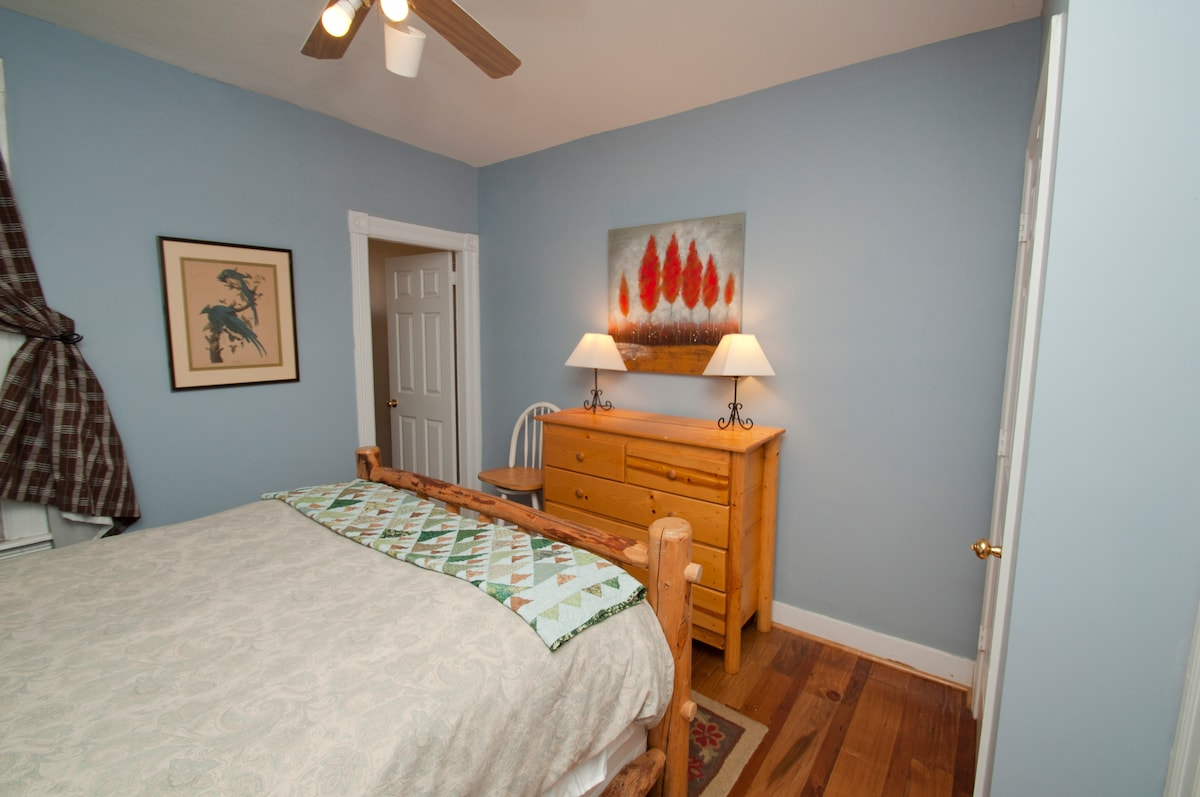 This is the view of dresser and door into the side room which is a den with a soft bed that pull-out.