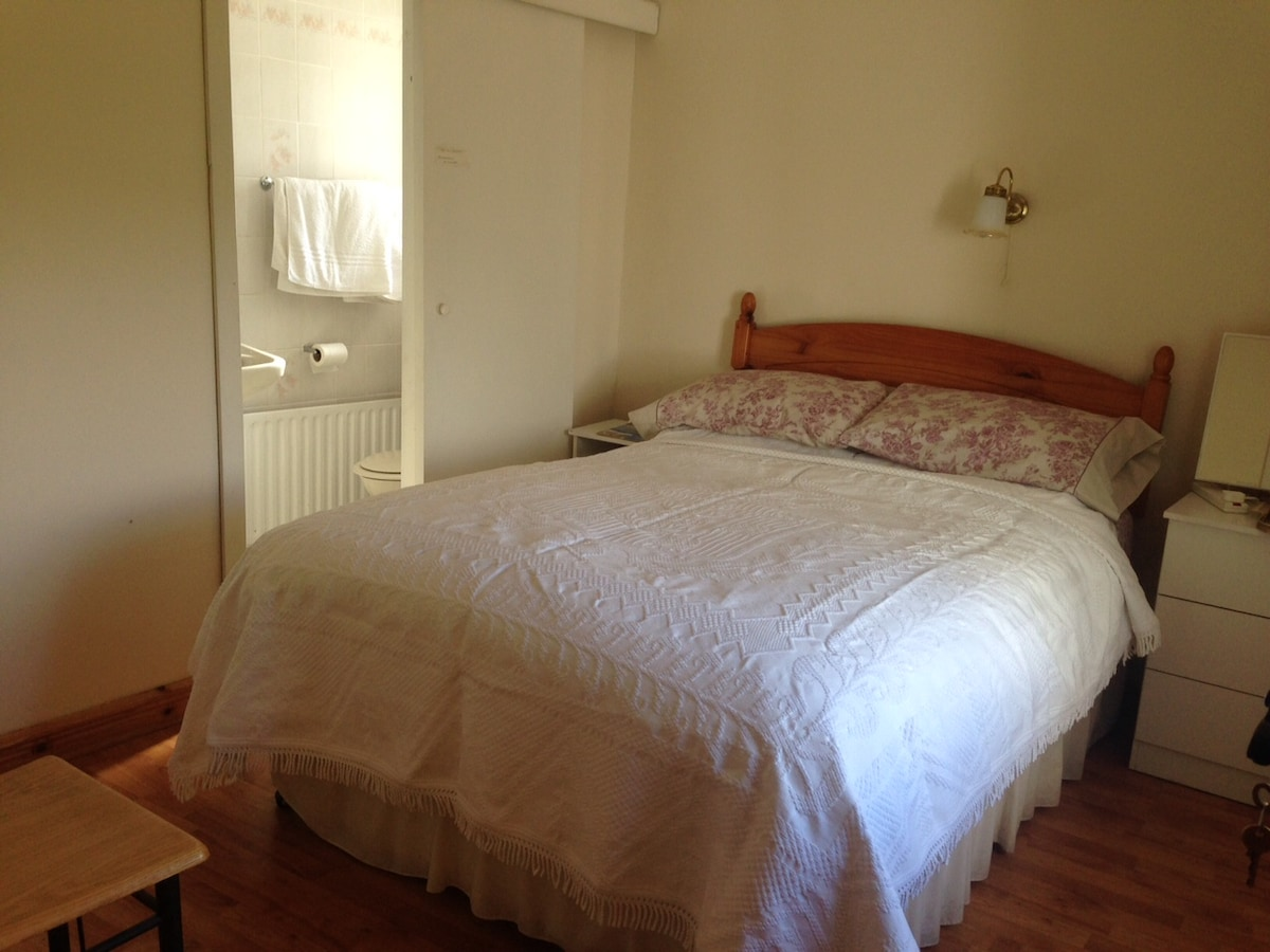 Double bedroom with TV, private en-suite, hill views