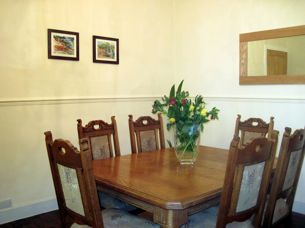 Separate dining room with lovely period dining table