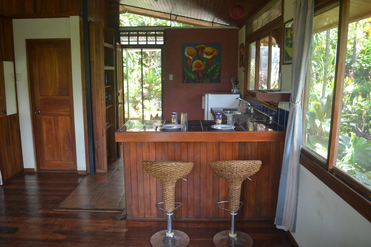 Kitchen bar stools, bathroom door, and kitchen door