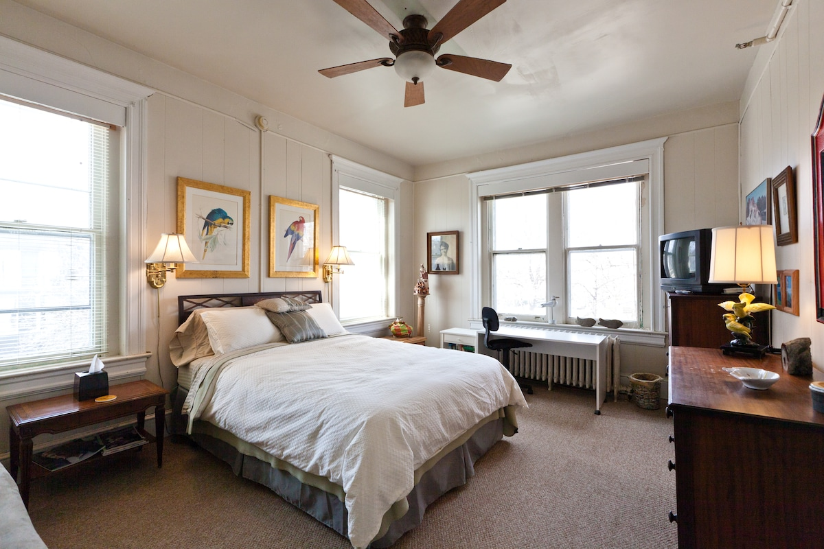 """Room #3 is airy and spacious with a colorful, whimsical """"animal theme"""" decor."""