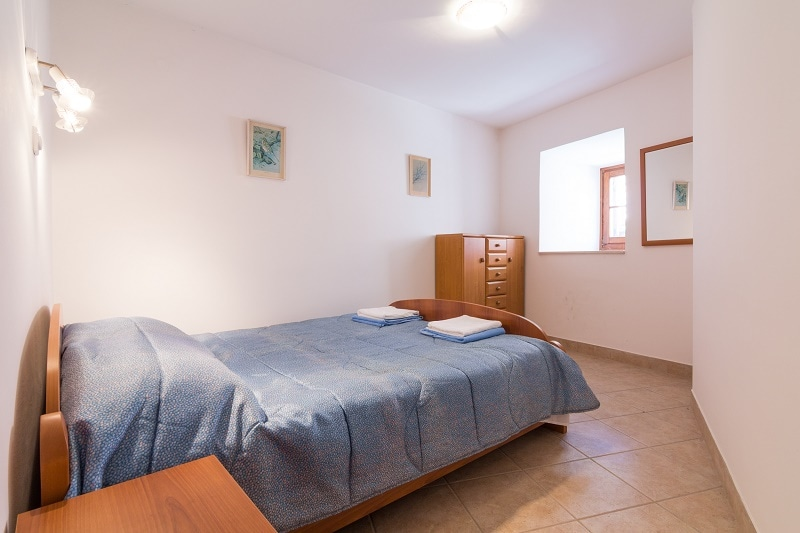 Bright bedroom with double bed.