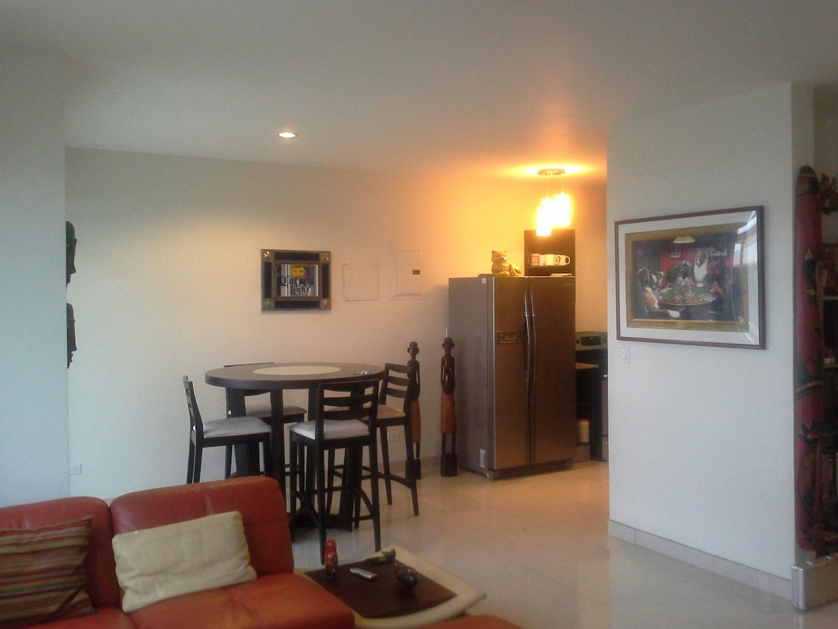 nice large open space includes living room, dining room, open kitchen, and on right is office area.