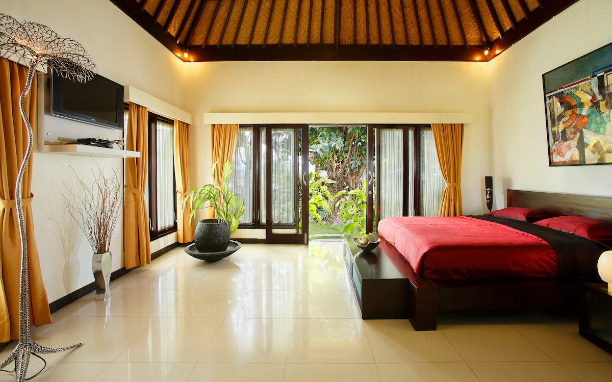 The master bed room with flat screen TV. Swimming pool and beach view.