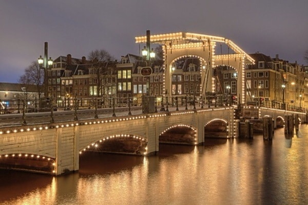 Skinny Bridge at Amstel river by night.