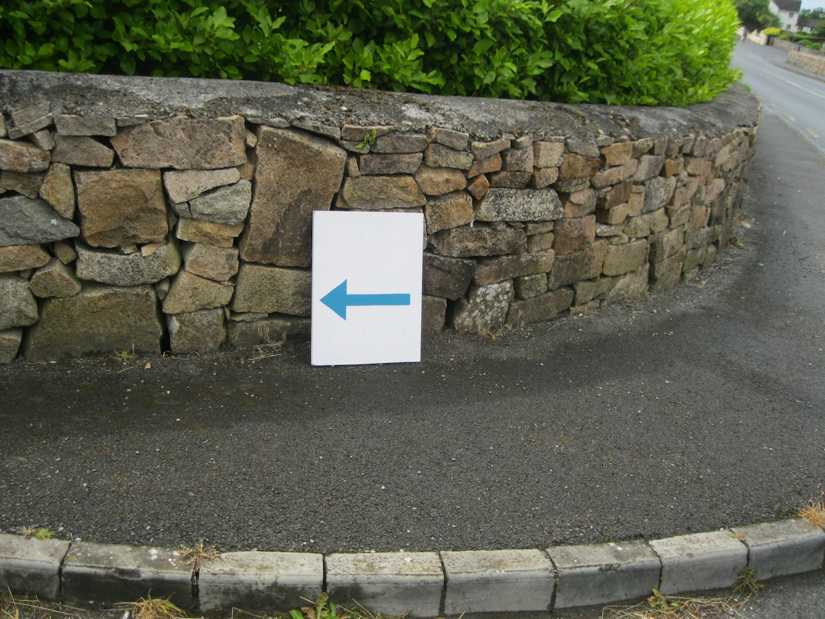 This sign sits at the top of our road, so you know where to go!