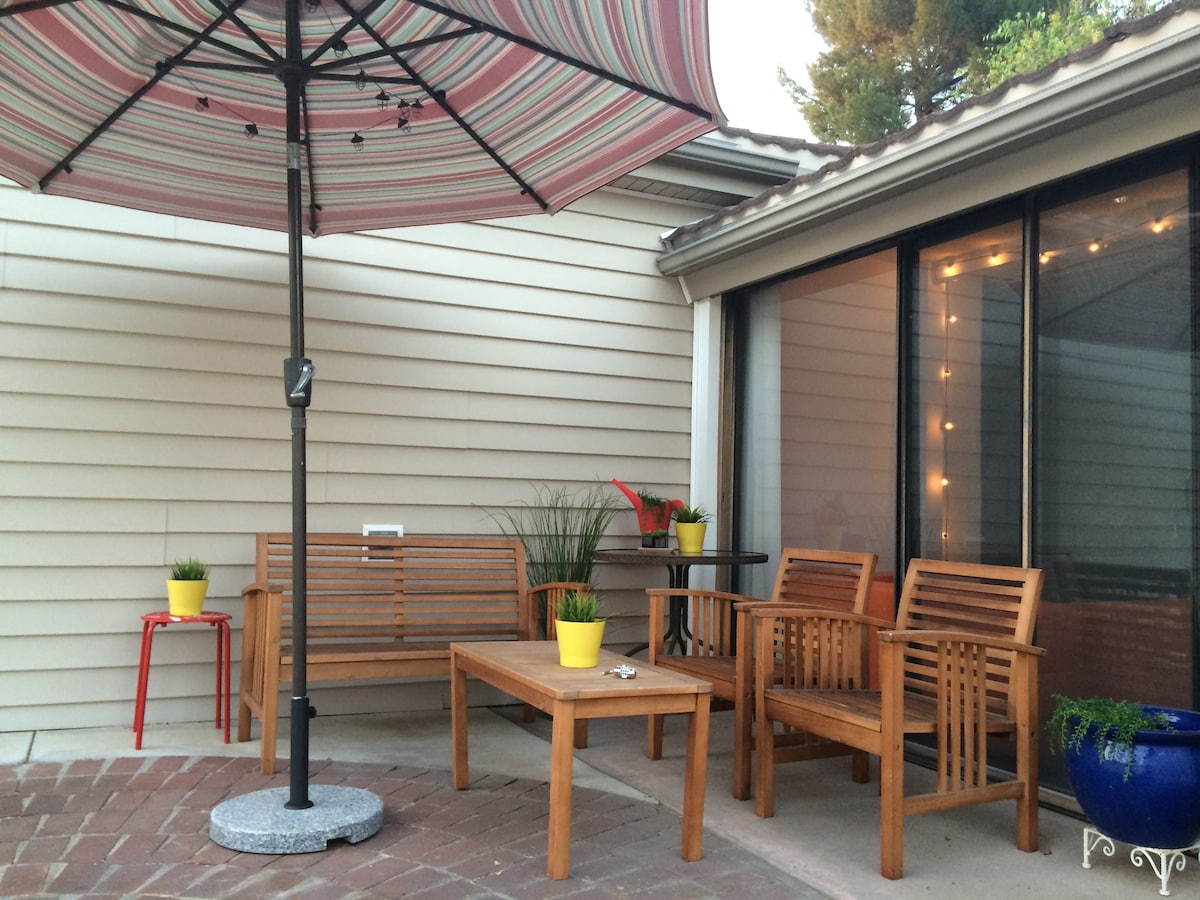 Virtual Tour: Park in the private driveway and come in through the gate and enjoy your own patio chillspace. The umbrella tilts to wherever you need it. Solar twinkle lights are always fun too.