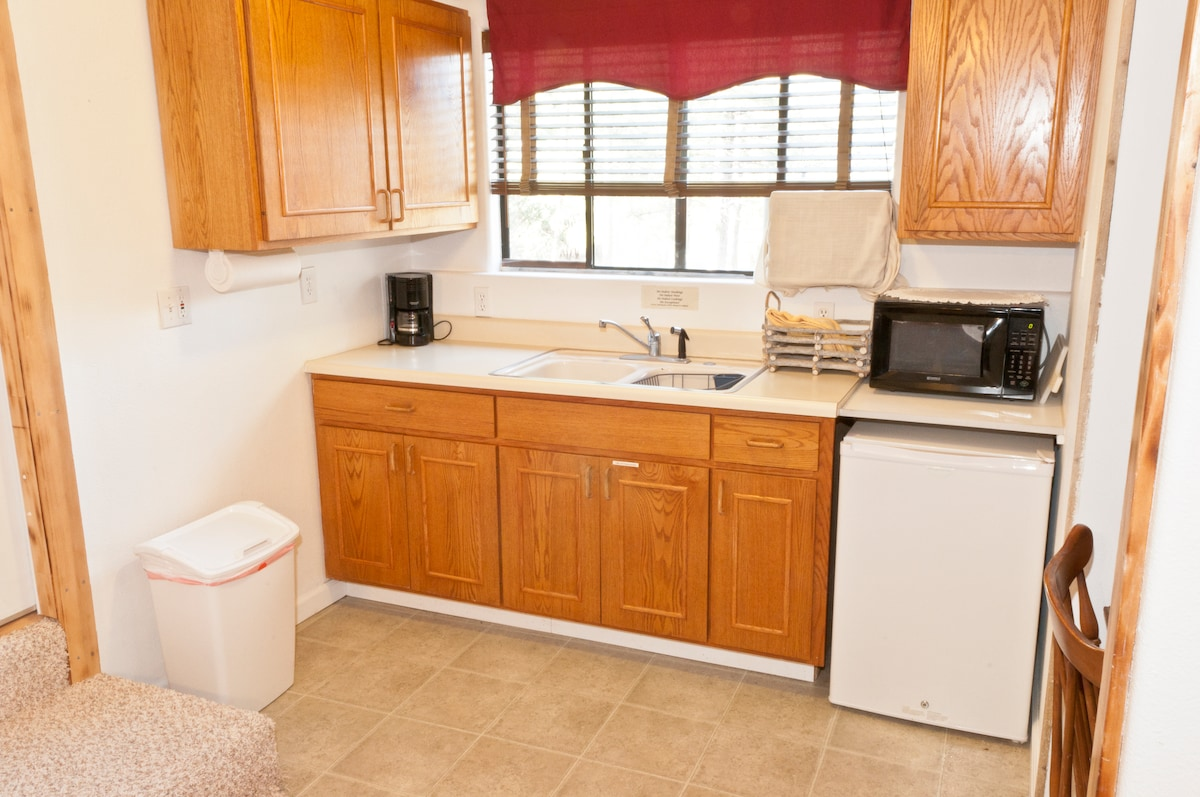 fridge, microwave, sink, coffee maker, cutting board with knives and basic kitchen supplies. Sorry no stove or cooktop, outdoor BBQ provided.