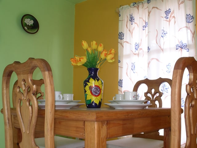 Dining area has seats for four guests.
