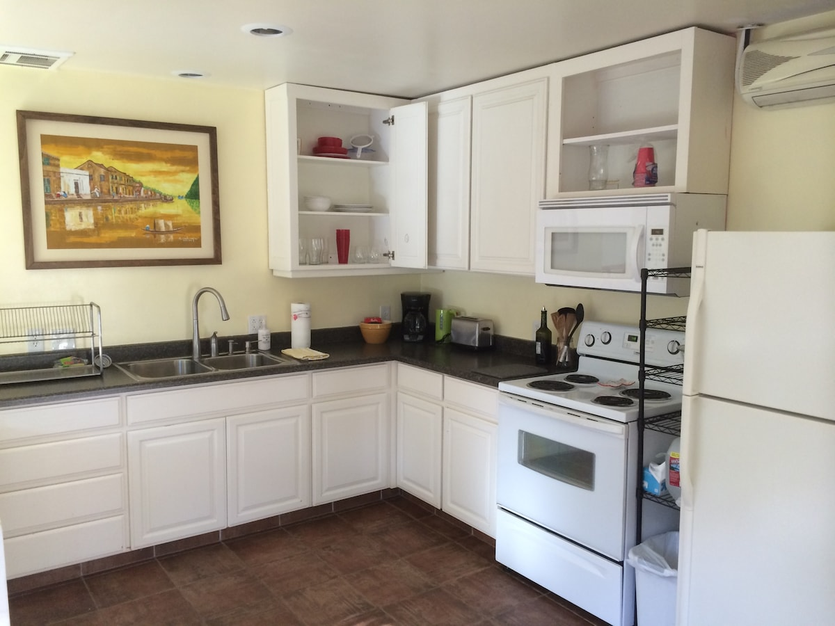 Fully functioning kitchen with split AC and heating system above the fridge