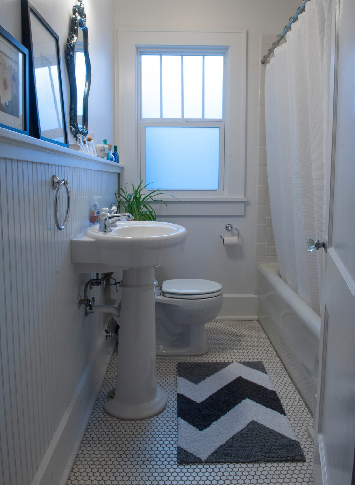 Your bright, clean, private bathroom with shower and tub.