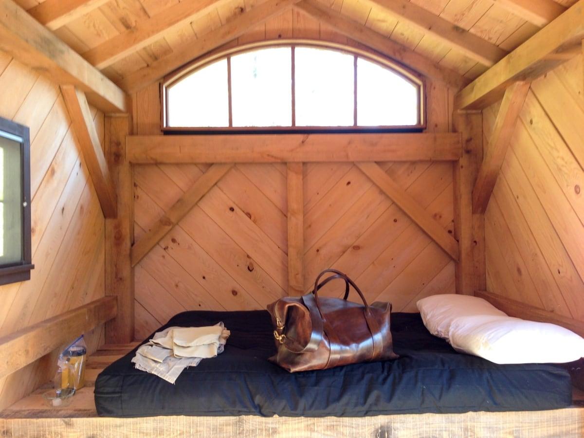 Futon sleeping platform in cabin, east wall.