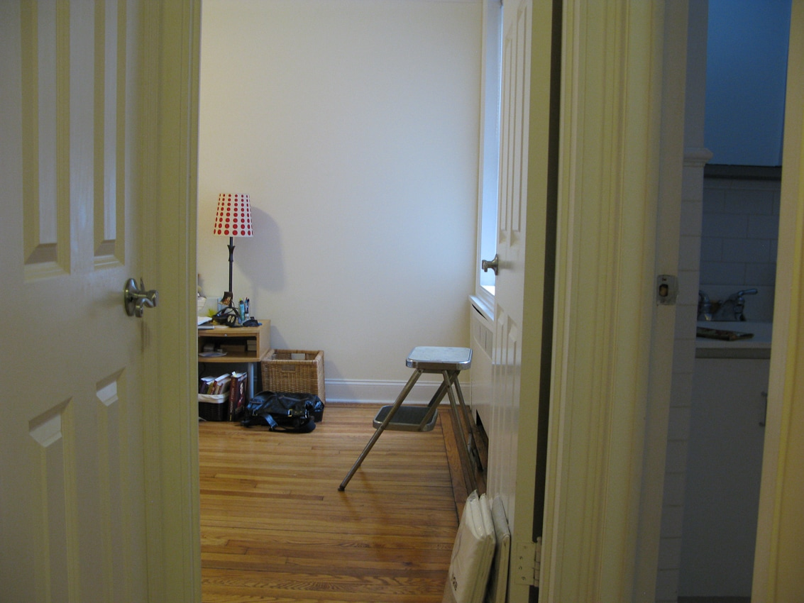 Another view of the bedroom w/ door to bathroom to the right.