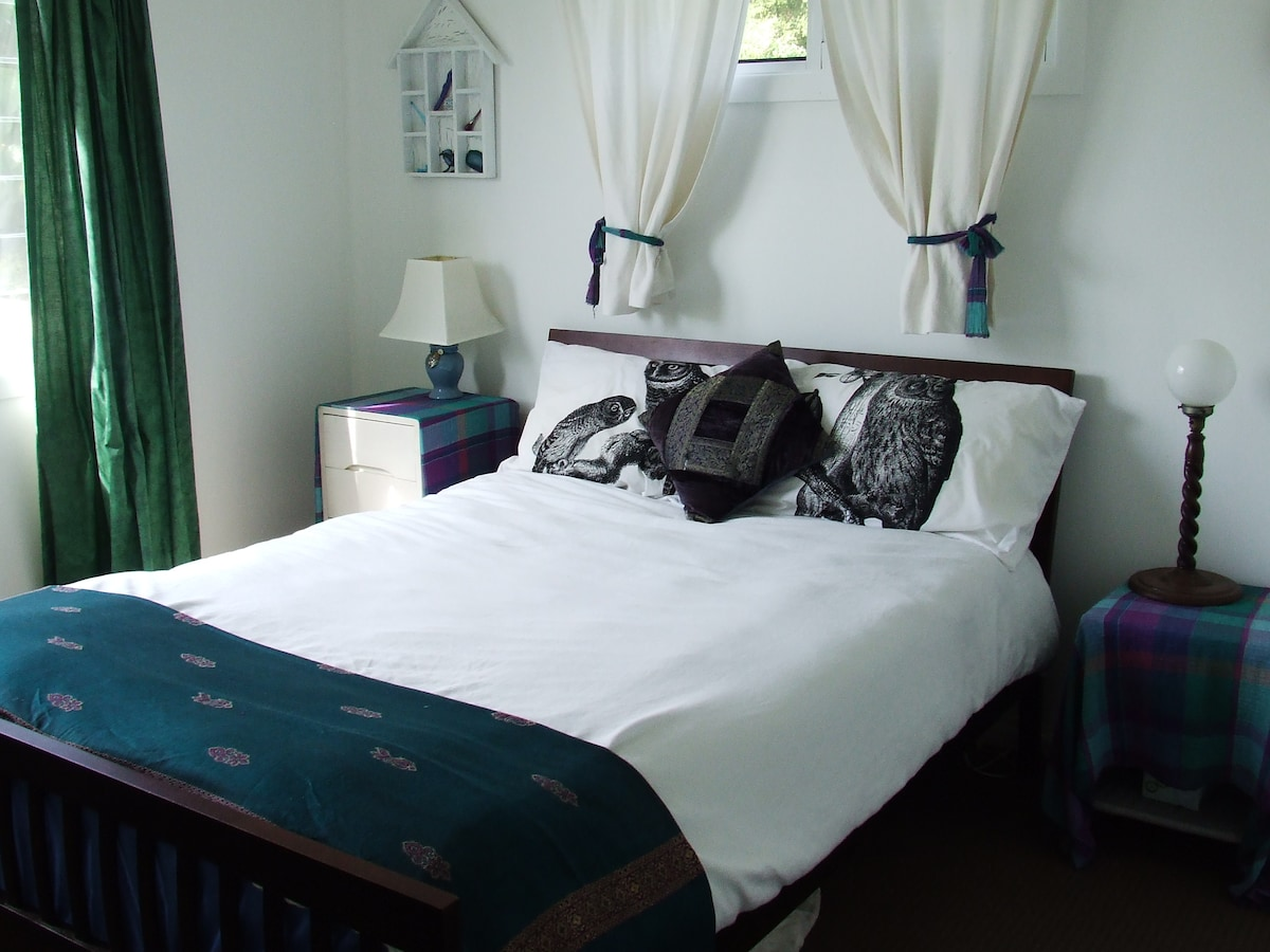 Double bedroom with ocean glimpses