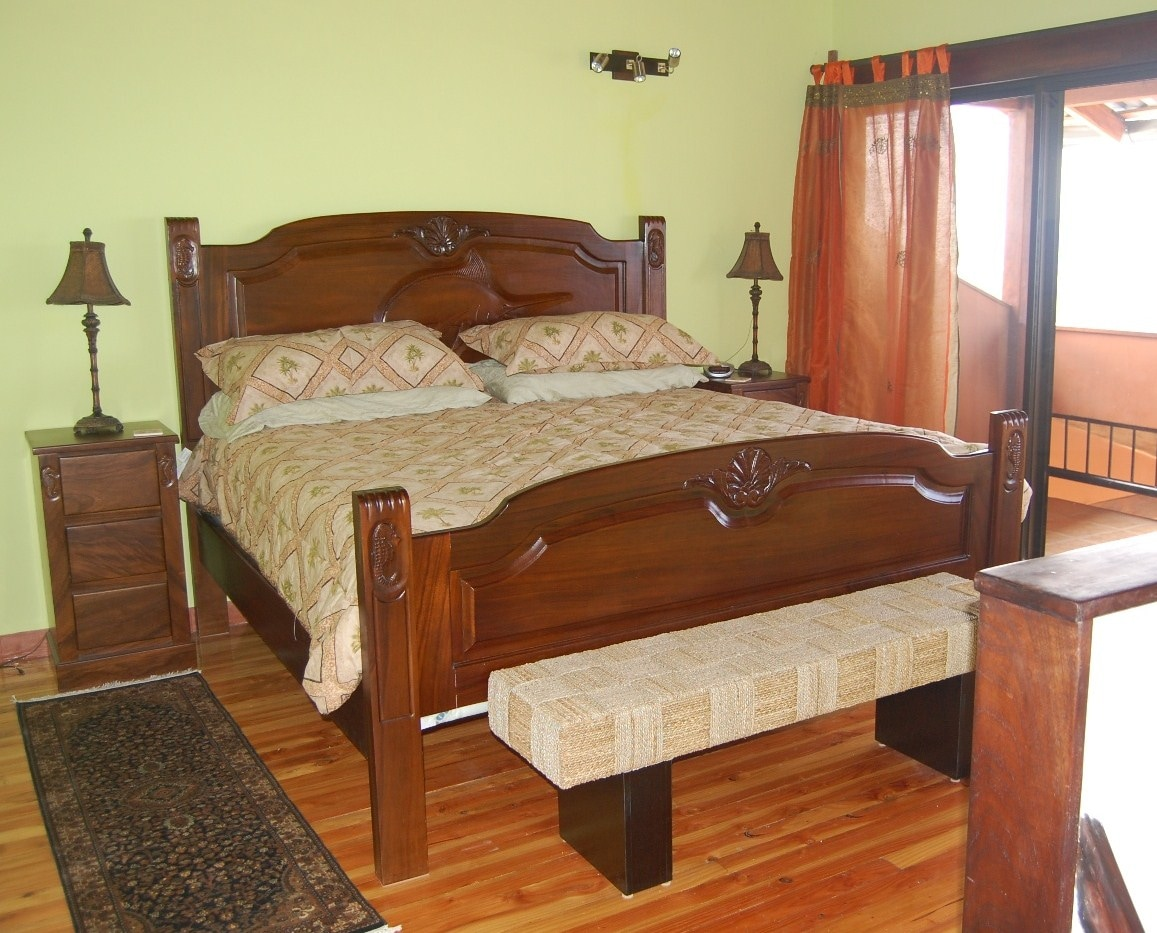 Master level with hand carved marlin headboard ..king size bed