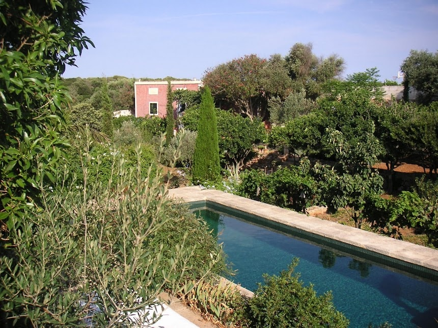 view of the house and garden from the pool side