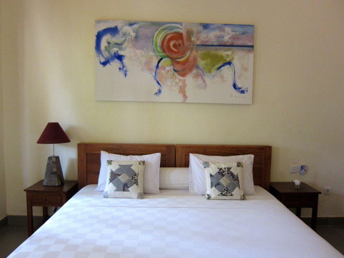 Larger than king size, or 2 large single beds, with the most comfy mattresses and top quality linen.