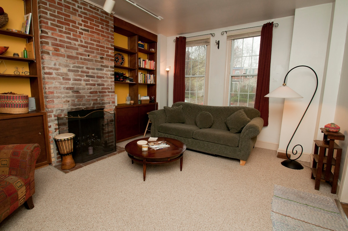 Spacious living room looks out onto quiet and quaint residential street in famed Eastern Market neighborhood.