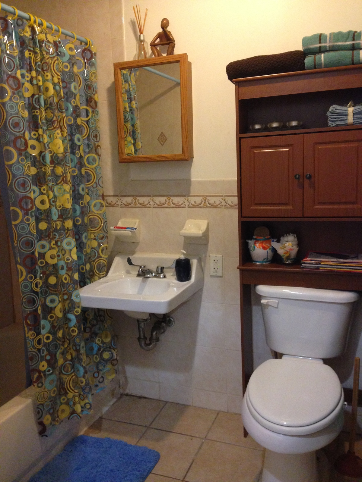 Your clean, private bathroom with full bathtub and shower is adjacent to your room. Towels, wash cloths, and hair dryer provided.