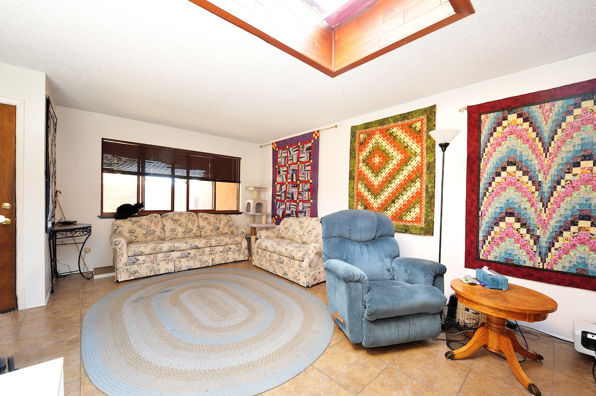 Another view of the living room and more quilts.