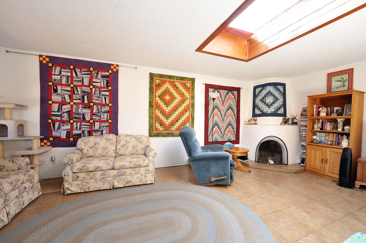 The living room area with the kiva fireplace.  Check out the quilts.