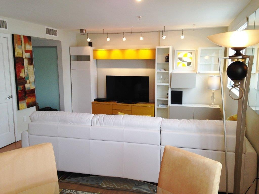 Living room with big screen TV and surrouding sound system