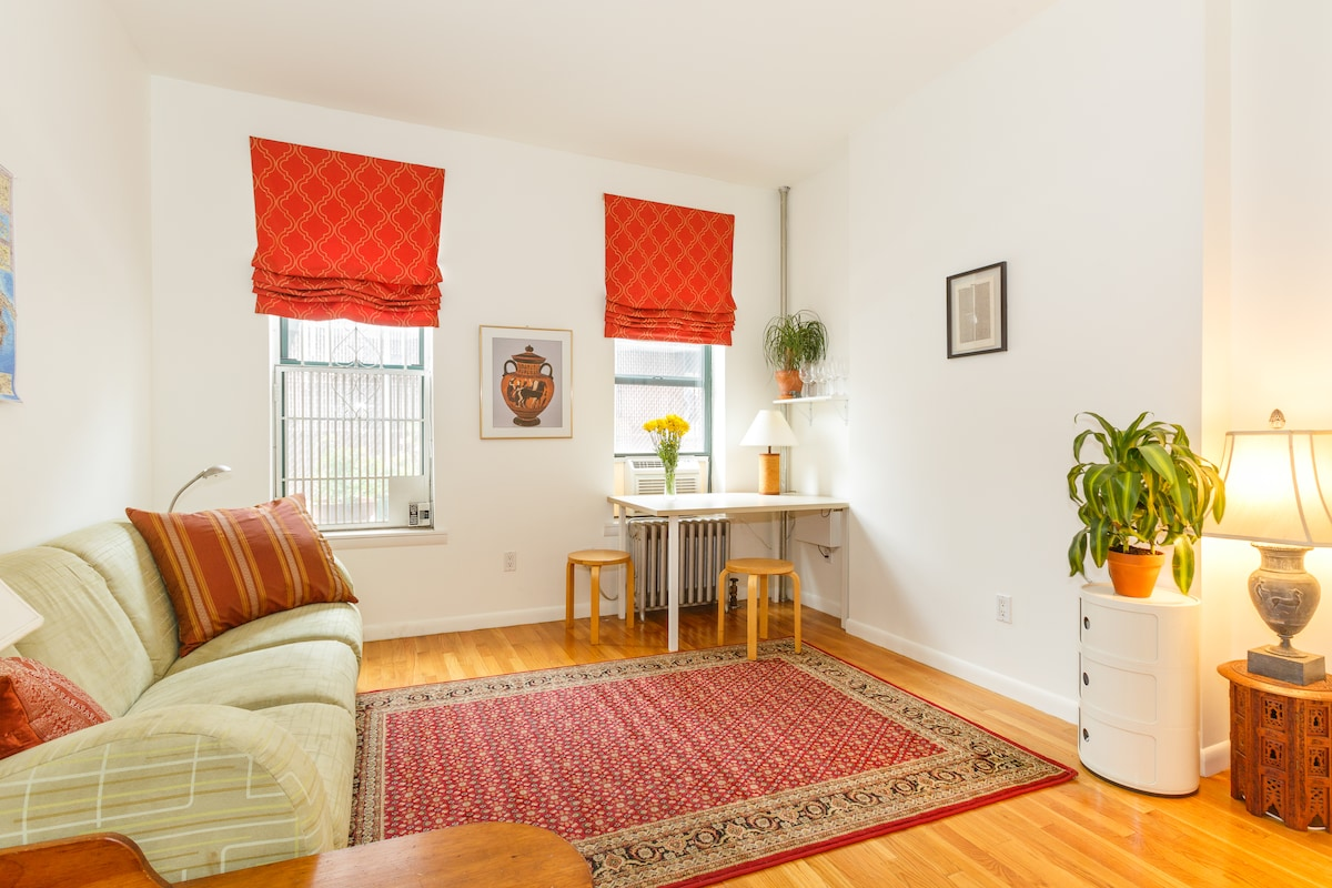 Living room. Enjoy the beautiful light of a recently renovated 1920s East Village apartment.