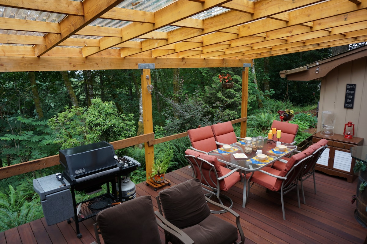 Covered Brazilian hardwood deck overlooks woods