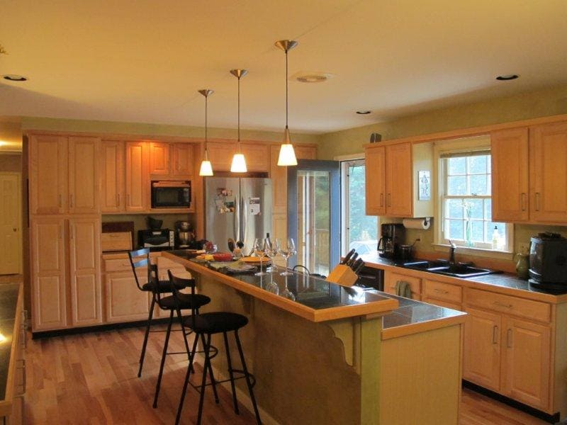Open eat-in kitchen that opens onto large deck overlooking large private back yard.