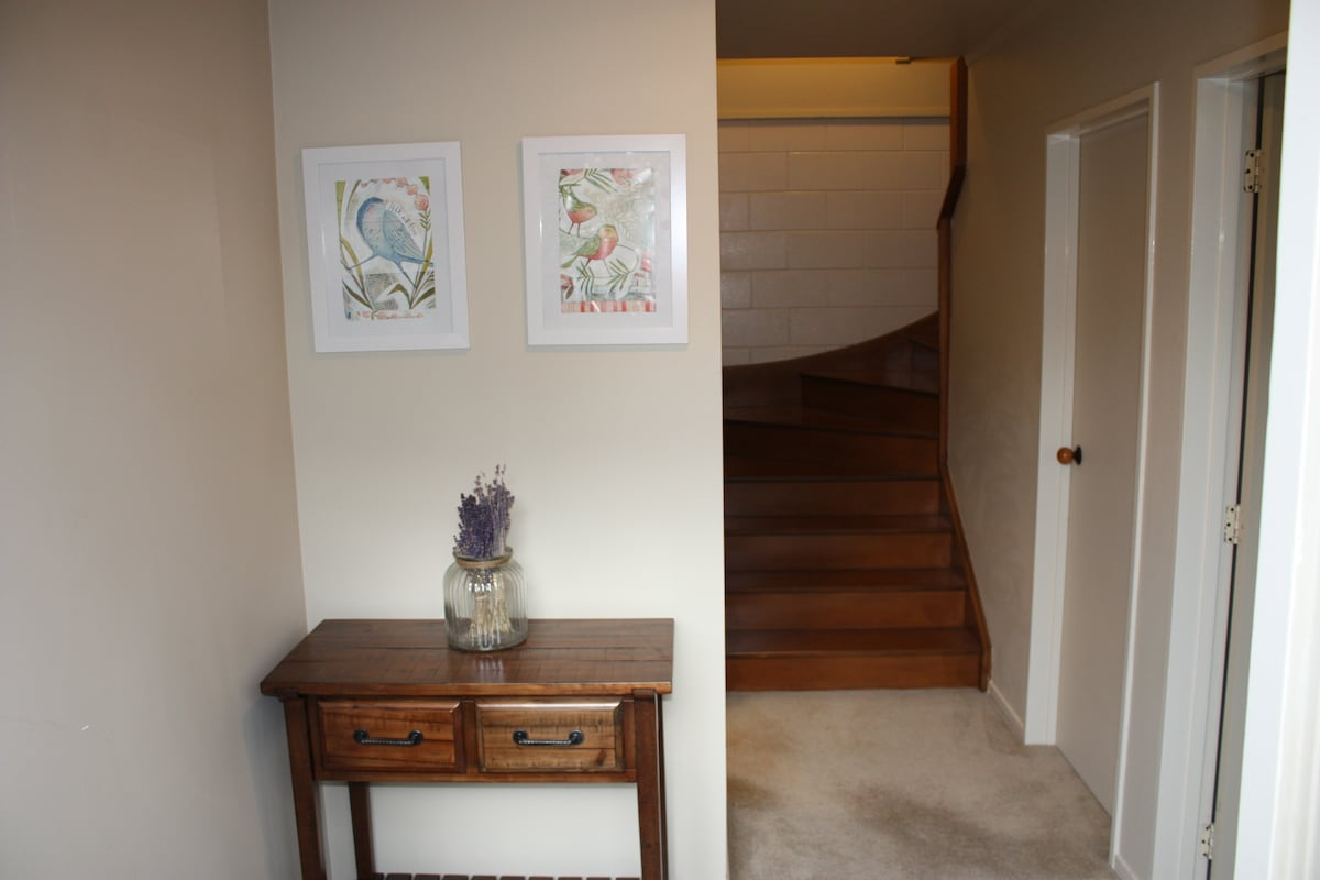 Bathroom and separate toilet on this level. Stairs leading up to main living area.