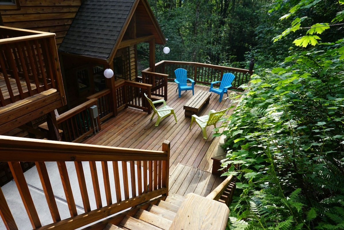 Relax on the wonderful cedar deck, the first of many outdoor levels on this dynamic property.