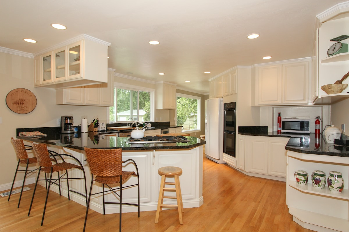 Spacious bright and airy kitchen. Open floor plan with kitchen and dining room opening to the backyard.