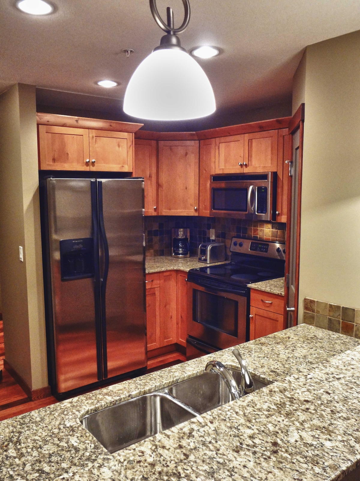 New stainless steel appliances, granite counter-tops, cookware and dining gear included.