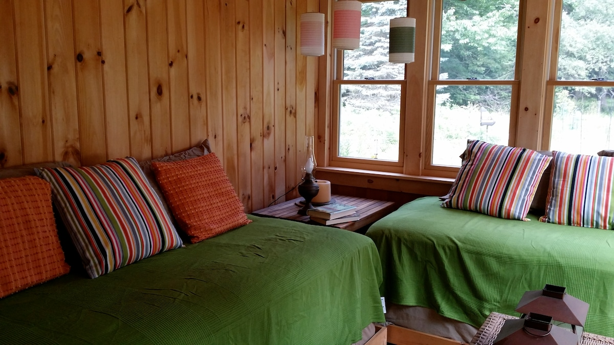 Sleeping porch with two twin beds. Great for watching fireflies after dusk.