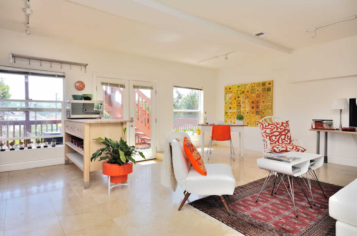 Stone floors, lots of windows, and bright colors keep the space light and fun.