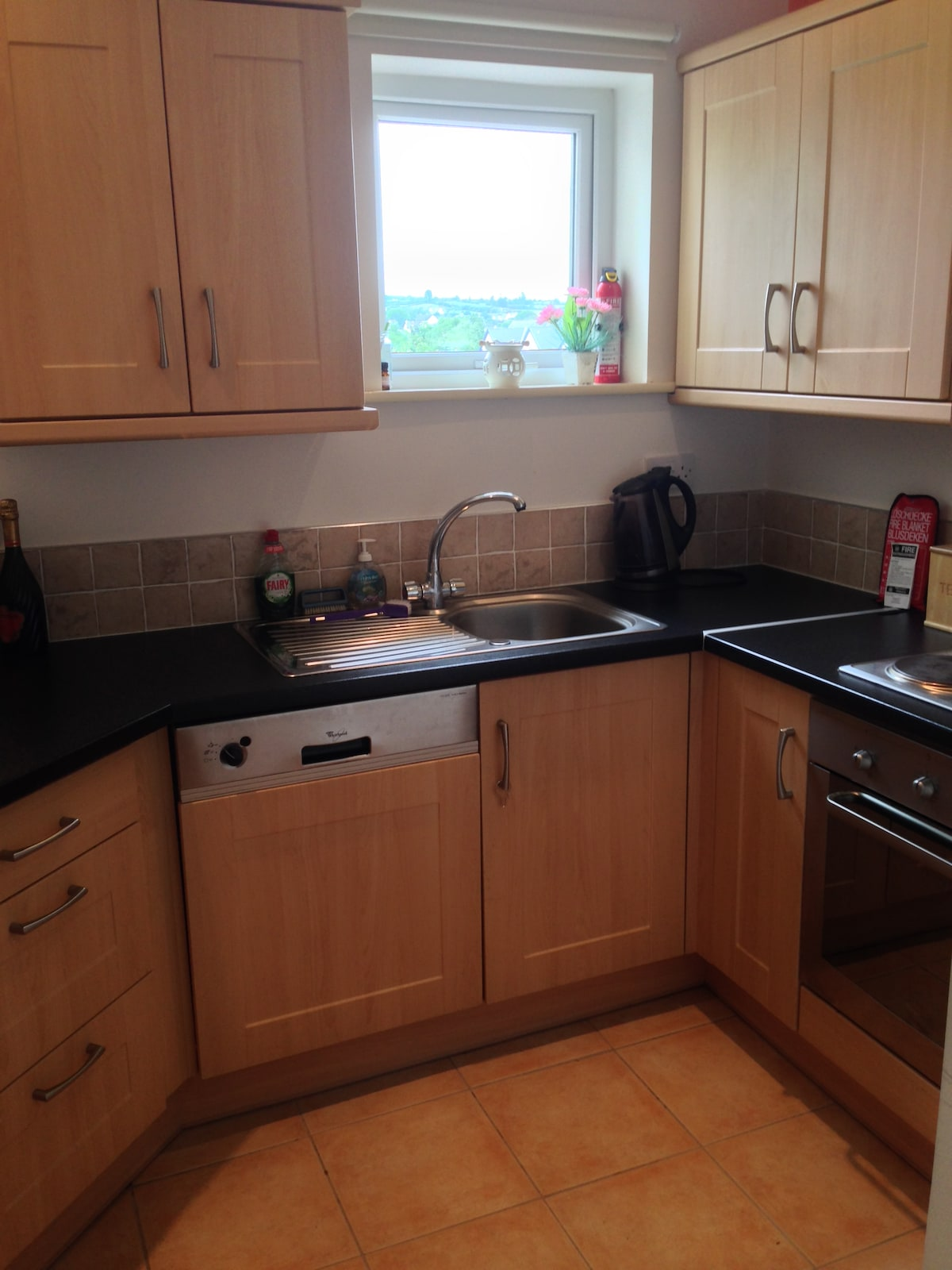 Kitchen, Oven, Electric hob, dish washer, washing machine/dryer. Microwave. Cutlery and place settings for 5