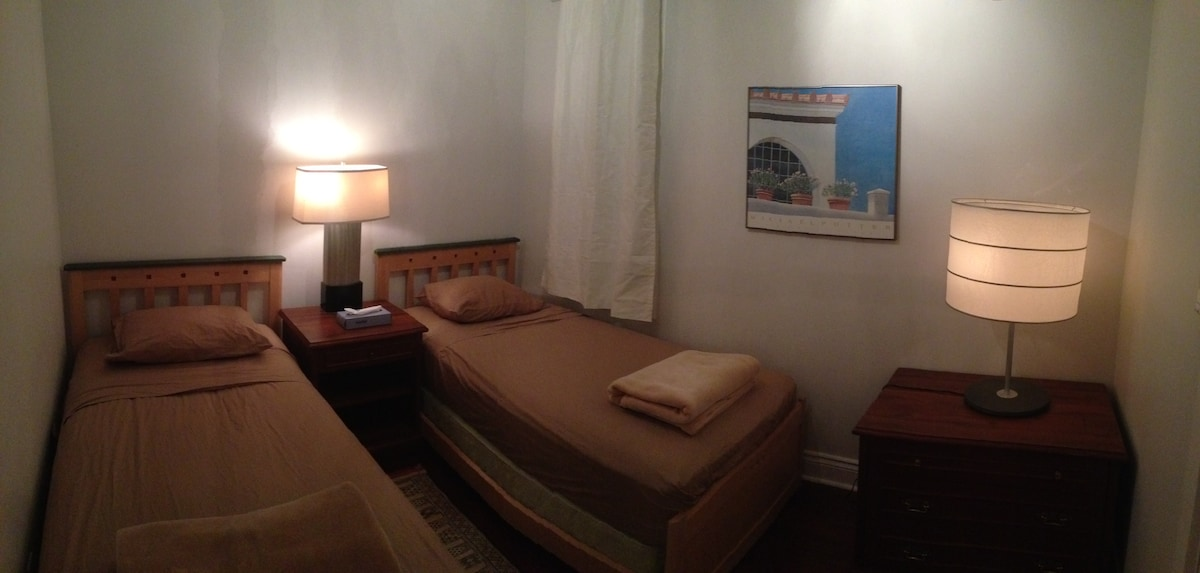 Two comfortable single beds in 2nd bedroom with ample closet.