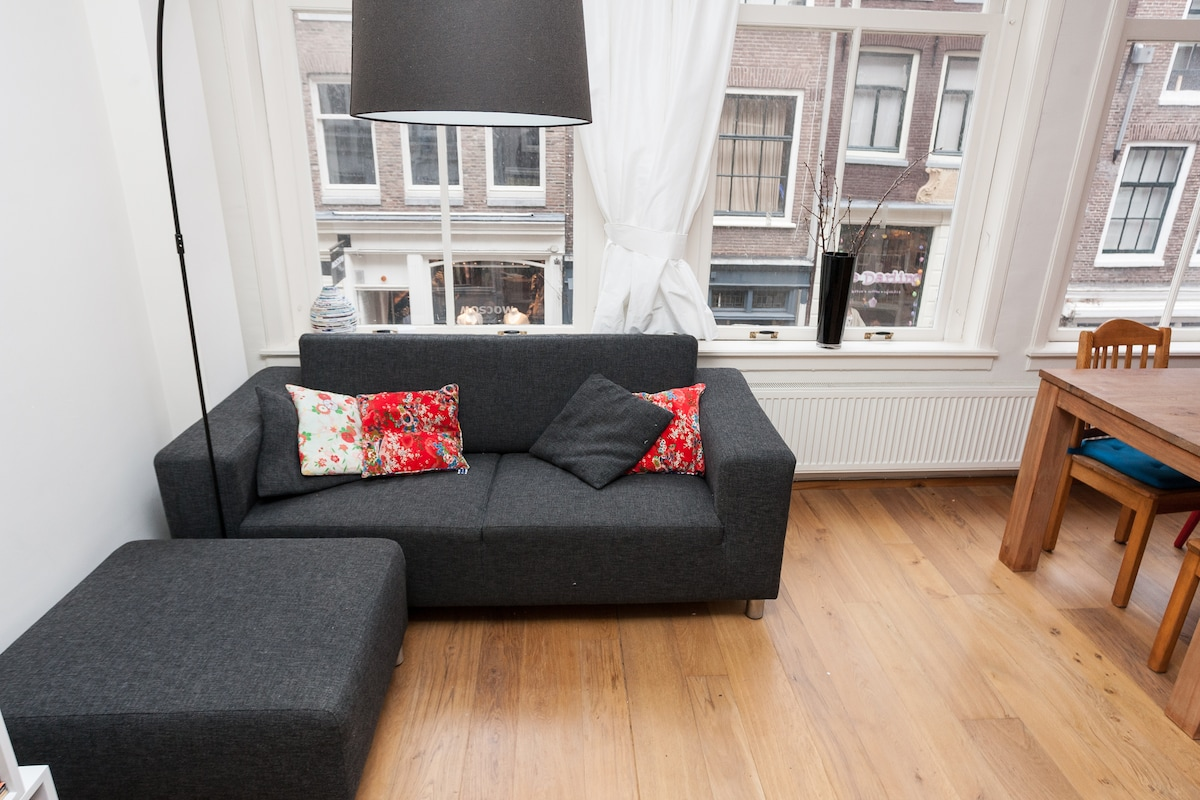 Please have a seat on the comfy couch during your busy city break!