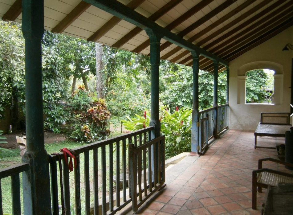 The front verandah that leads to the lush garden.
