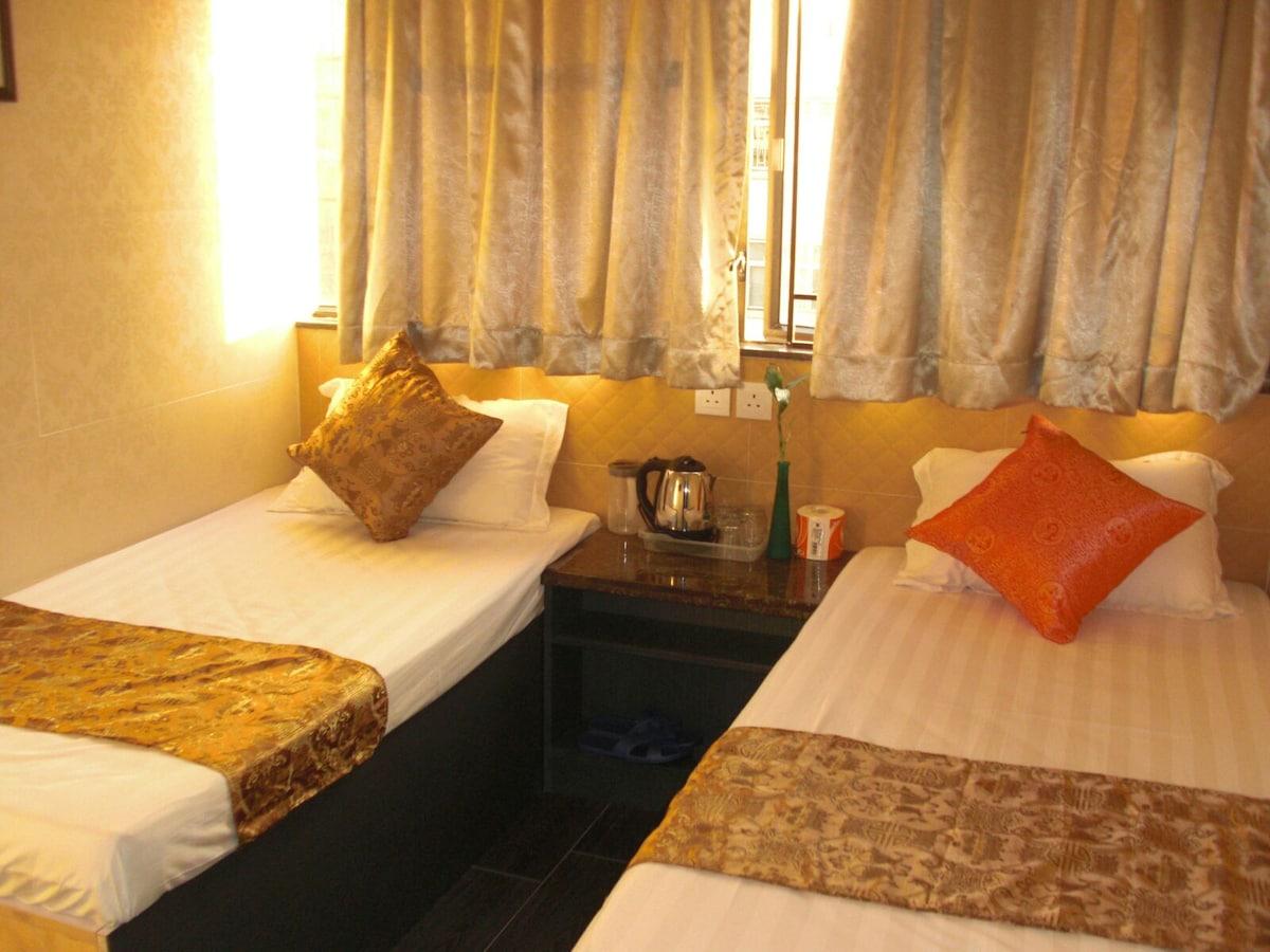 Cozy Triple room in nathan road Kln