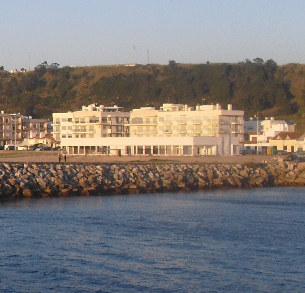 Front view of the building. Photo taken from the safe harbor for boating and fishing