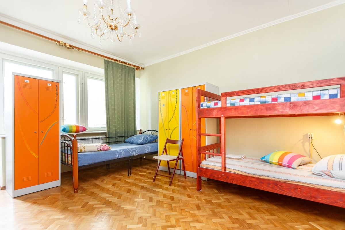 large 7-bed shared room (lockers, balcony, comfy beds and pillows)