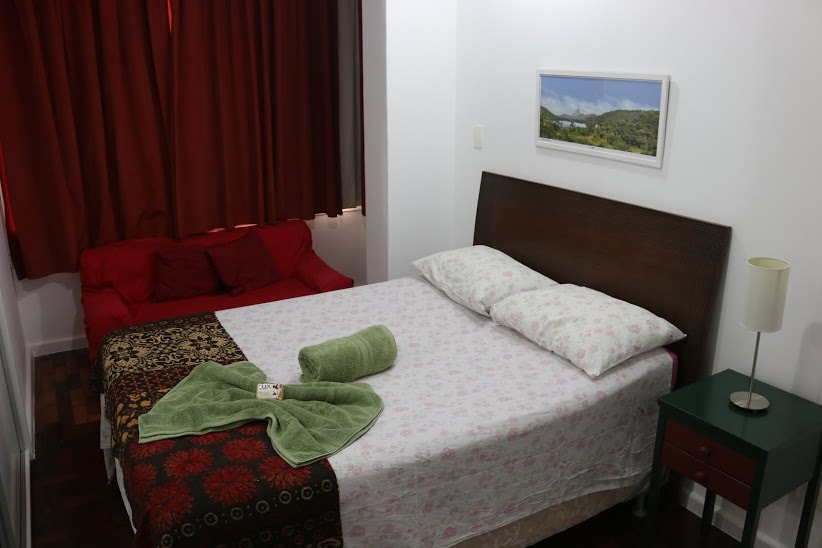 En suite bedroom with AC, full size bed and ample storage space