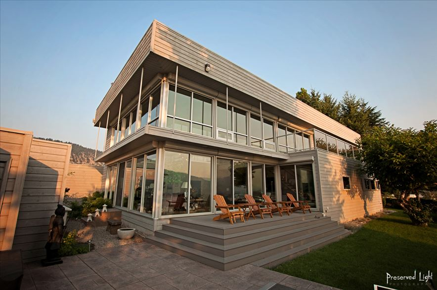 Lakeside front of villa Orion. Floor to ceiling glass is providing dramatic views and is provoking a spectacular fascination. And is introducing incoming light deep into our home interior, which is even more accentuated by many crystals spread through our