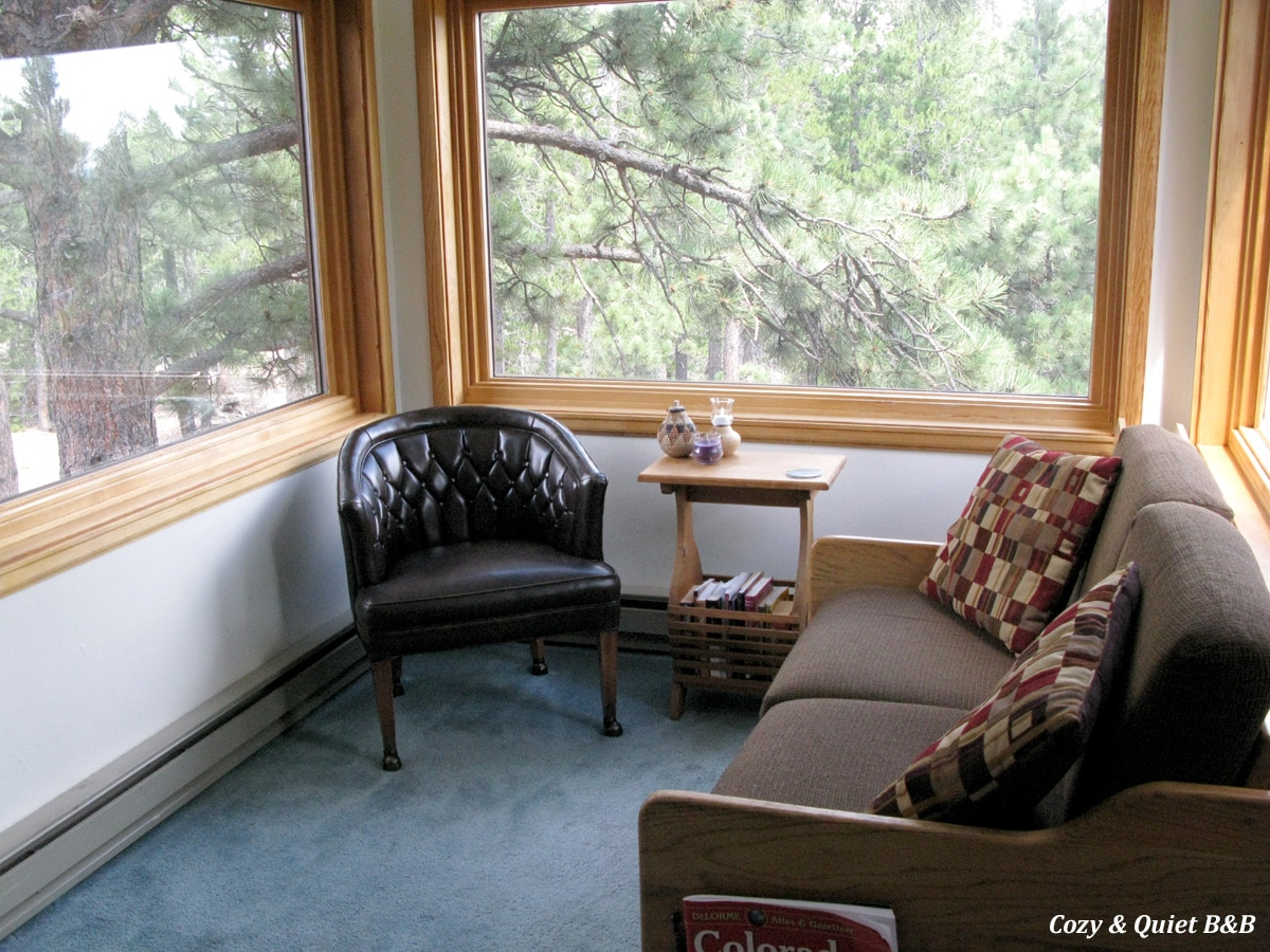 "the living room space, surrounded by trees ... why many people refer to our place as ""the tree house"""